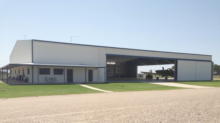 Aircraft hangar with additional office space by ABC Sheds